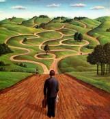 Man Standing At Beginning Of Winding Road
